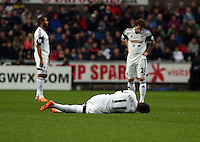 Wednesday, 01 January 2014<br /> Pictured: Pablo Hernandez of Swansea injured on the ground with a suspected hamstring injury.<br /> Re: Barclay's Premier League, Swansea City FC v Manchester City at the Liberty Stadium, south Wales.