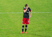 WASHINGTON, DC - NOVEMBER 8: Julian Gressel #14 of D.C. United stands on the field after a game between Montreal Impact and D.C. United at Audi Field on November 8, 2020 in Washington, DC.