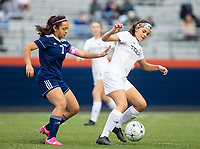 Azucena Carbajal (7) of Rogers Heritage and Amanda Schell (10) of Bentonville fight for the ball  at David Gates Stadium, Rogers, Ark., on Tuesday,, March 30, 2021  / Special to NWA Democrat-Gazette/ David Beach