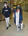 MIAMI, FL - JULY 15: (EXCLUSIVE COVERAGE) Garcelle Beauvais (C) is seen at Miami International Airport with her son Jaid Thomas Nilon on July 15, 2021 in Miami, Florida.  (Photo by Vallery Jean / jlnphotography.com )
