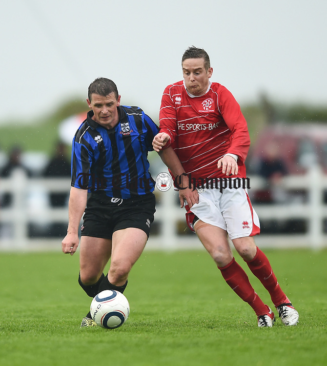 Anton Mannering of Bridge United in action against Daithi O Connell of Newmarket Celtic during their Cup final at Doora. Photograph by John Kelly.