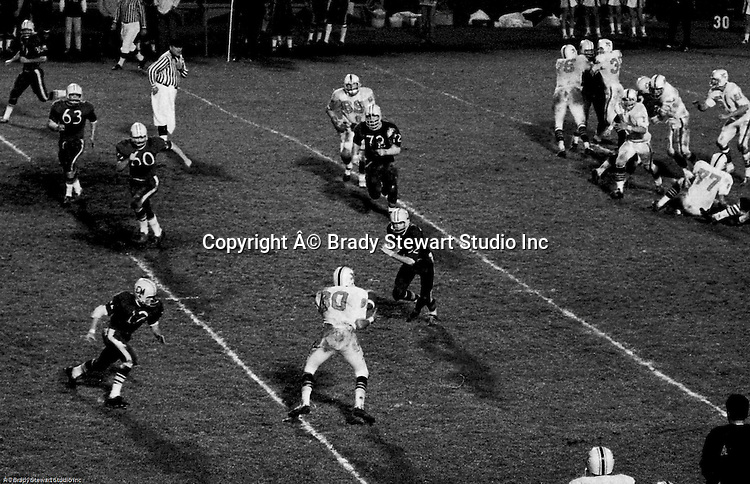 Bethel Park PA:  Offensive play with Bruce Evanovich 80 catching a button hook pass from Mike Stewart 11 after excellent blocking from the offensive line and backs.  The offense and defense played very well in the  14-0 victory over Canon McMillan. Others in the photo; Dennis Franks 66, Bob Hensler 77, Joe Barrett, 75, Don Troup 51, Chip Huggins 32, Glenn Eisaman 71.  The defensive unit was one of the best in Bethel Park history only allowing a little over 7 points a game.