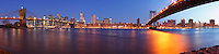 Brooklyn Bridge, Lower Manhattan, and the Manhattan Bridge as seen from Brooklyn Bridge Park at Dawn.