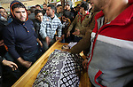Relatives mourn during the funeral of Ishaq Hassan, 28, who was shot dead by Egyptian border guards as he crossed from the Gaza Strip into Egypt, on December 31, 2015 in Gaza city. Ishaq Hassan, who was said to suffer from mental illness, was shot dead after he crossed naked the posts and fencing marking the border between the Palestinian enclave and Egypt. Photo by Mohammed Asad