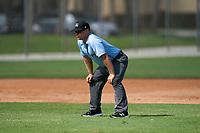 Umpire Denver Dangerfield during a Gulf Coast League game between the GCL Astros and GCL Cardinals on August 11, 2019 at Roger Dean Stadium Complex in Jupiter, Florida.  GCL Cardinals defeated the GCL Astros 2-1.  (Mike Janes/Four Seam Images)