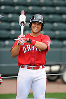 Infielder Michael Chavis (11) of the Greenville Drive, a 2014 first-round pick of the Boston Red Sox, laughs with a teammate during batting practice at a Media Day workout on Tuesday, April 7, 2015, at Fluor Field at the West End in Greenville, South Carolina. (Tom Priddy/Four Seam Images)