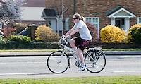Leisure cyclist, Thames Ditton, Surrey.