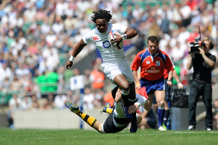 Marland Yarde of England runs through the tackle of Elliot Daly of the Barbarians during the match between England and Barbarians at Twickenham on Sunday 26th May 2013 (Photo by Rob Munro)