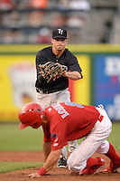 Tampa Yankees shortstop Tyler Wade (17) tags out Devin Lohman (8) in a run down after getting picked off during a game against the Clearwater Threshers on April 21, 2015 at Bright House Field in Clearwater, Florida.  Clearwater defeated Tampa 3-0.  (Mike Janes/Four Seam Images)