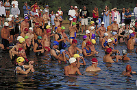 swimmers at start of competition in triathalon event in lake. people. CA USA lake.