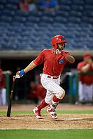 Clearwater Threshers second baseman Raul Rivas (13) follows through on a swing during a game against the Jupiter Hammerheads on April 12, 2018 at Spectrum Field in Clearwater, Florida.  Jupiter defeated Clearwater 8-4.  (Mike Janes/Four Seam Images)
