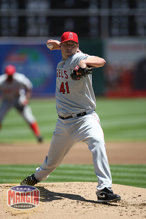OAKLAND, CA - JULY 19:  John Lackey #41 of the Los Angeles Angels of Anaheim pitches against the Oakland Athletics during the game at the Oakland-Alameda County Coliseum on July 19, 2009 in Oakland, California. Photo by Brad Mangin