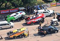 Apr. 28, 2012; Baytown, TX, USA: NHRA funny car drivers (top to bottom) Jack Beckman , Gary Densham and Jeff Arend during qualifying for the Spring Nationals at Royal Purple Raceway. Mandatory Credit: Mark J. Rebilas-