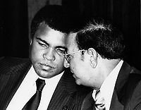 Montreal (Qc) Canada -  Canada. File photo - ca 1980 - Muhammad Ali (L) discusss with a famous boxing trainer