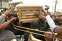 Mourners carry the casket of Dinerral Shavers, 25, who died from a gunshot to the back of his head in New Orleans, Sat., Jan. 6, 2007. Shavers was the snare drummer for the Hot 8 Brass Band and the music teacher at L.E. Rabouin High School, where he had recently begun the school's first-ever marching band. He was killed by a teen who was trying to shoot his stepson. <br /> <br /> (AP Photo/Cheryl Gerber)