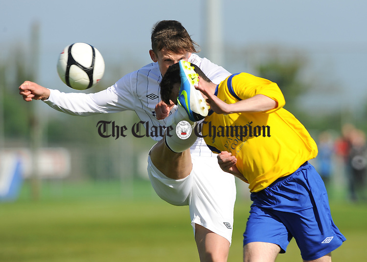 Gavin Mc Dermott of AUL Dublin in action against Paddy O Malley of Clare League during the Oscar Traynor Trophy Final at AUL Complex, Clonshaugh, Dublin. Photograph by John Kelly.