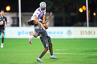 LAKE BUENA VISTA, FL - AUGUST 06: Joao Moutinho #4 of Orlando City SC and Raheem Edwards #44 of Minnesota United FC battle for the ball during a game between Orlando City SC and Minnesota United FC at ESPN Wide World of Sports on August 06, 2020 in Lake Buena Vista, Florida.