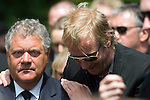 Actor Rhys Ifans comforting the entertainer Max Boyce at the funeral of Stuart Cable at St Elvan's Church in the centre of Aberdare today. The former Stereophonics drummer was found dead at his home on 7th June.
