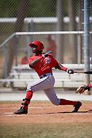 Washington Nationals Victor Robles (13) follows through on a swing during a minor league Spring Training game against the St. Louis Cardinals on March 27, 2017 at the Roger Dean Stadium Complex in Jupiter, Florida.  (Mike Janes/Four Seam Images)