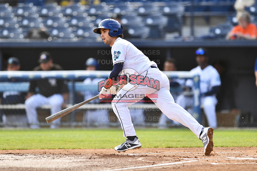 Asheville Tourists shortstop Terrin Vavra (6) swings at a pitch during game one of a double header against the Charleston RiverDogs at McCormick Field on April 9, 2019 in Asheville, North Carolina. The Tourists defeated the RiverDogs 17-3. (Tony Farlow/Four Seam Images)