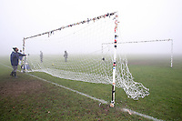 A Sunday footballer puts up the goal nets in fog before an East London Sunday League match at Hackney Marshes - 23/12/07 - MANDATORY CREDIT: Gavin Ellis/TGSPHOTO - Self billing applies where appropriate - Tel: 0845 094 6026