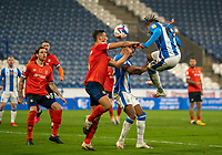 7th November 2020 The John Smiths Stadium, Huddersfield, Yorkshire, England; English Football League Championship Football, Huddersfield Town versus Luton Town; Josh Koroma of Huddersfield Town challenged by Matty Pearson of Luton Town in the air