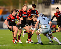 20130127 Copyright onEdition 2013©.Free for editorial use image, please credit: onEdition..Nick Auterac of Saracens (left) faces up to Michael Paterson of Cardiff Blues as Petrus du Plessis (centre) and Eoin Sheriff of Saracens support during the LV= Cup match between Saracens and Cardiff Blues at Allianz Park on Sunday 27th January 2013 (Photo by Rob Munro)..For press contacts contact: Sam Feasey at brandRapport on M: +44 (0)7717 757114 E: SFeasey@brand-rapport.com..If you require a higher resolution image or you have any other onEdition photographic enquiries, please contact onEdition on 0845 900 2 900 or email info@onEdition.com.This image is copyright onEdition 2013©..This image has been supplied by onEdition and must be credited onEdition. The author is asserting his full Moral rights in relation to the publication of this image. Rights for onward transmission of any image or file is not granted or implied. Changing or deleting Copyright information is illegal as specified in the Copyright, Design and Patents Act 1988. If you are in any way unsure of your right to publish this image please contact onEdition on 0845 900 2 900 or email info@onEdition.com