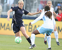 Allie Long (9) of the Washington Freedom cuts past Ifeoma Dieke (4) of the Chicago Red Stars during a WPS match at Maryland Soccerplex on April 11 2009, in Boyd's, Maryland.  The game ended in a 1-1 tie.