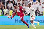 Assim Madibo of Qatar (L) fights for the ball with Ahmed Khalil Aljunaibi of United Arab Emirates (R) during the AFC Asian Cup UAE 2019 Semi Finals match between Qatar (QAT) and United Arab Emirates (UAE) at Mohammed Bin Zaied Stadium  on 29 January 2019 in Abu Dhabi, United Arab Emirates. Photo by Marcio Rodrigo Machado / Power Sport Images