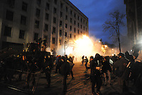Clashes between the protesters and the Riot police (Berkut) defending the Kiev city council building.The prostest was ignited by  the Ukrainian  government's decision to stall on a deal that would bring closer ties with the European Union.
