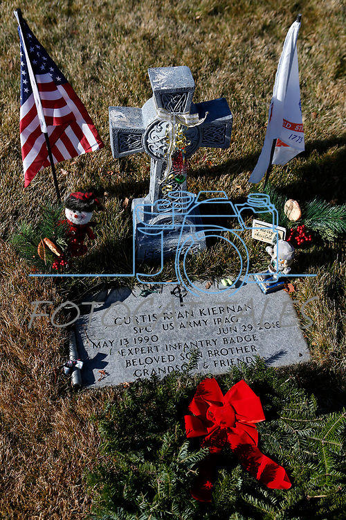 As part of National Wreaths Across America Day, volunteers place wreaths on the graves of veterans at the Lone Mountain Cemetery, in Carson City, Nev., on Saturday, Dec. 19, 2020. The program honors veterans at more than 2100 cemeteries around the world. <br /> Photo by Cathleen Allison/Nevada Momentum Fueled by RAD
