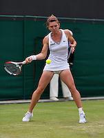 27-06-13, England, London,  AELTC, Wimbledon, Tennis, Wimbledon 2013, Day four, Simona Halep (ROU)<br /> <br /> <br /> <br /> Photo: Henk Koster
