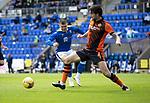 St Johnstone v Dundee United…22.08.21  McDiarmid Park    SPFL<br />Charlie Mulgrew clears ftom Glenn Middleton<br />Picture by Graeme Hart.<br />Copyright Perthshire Picture Agency<br />Tel: 01738 623350  Mobile: 07990 594431