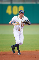 Montgomery Biscuits shortstop Daniel Robertson (4) warmup throw to first during a game against the Jackson Generals on April 29, 2015 at Riverwalk Stadium in Montgomery, Alabama.  Jackson defeated Montgomery 4-3.  (Mike Janes/Four Seam Images)