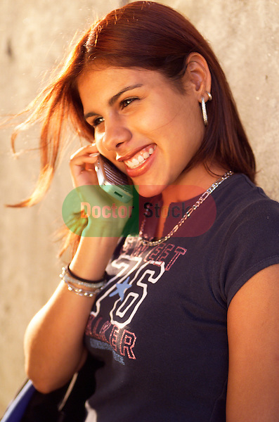 young woman smiling while talking on cellphone