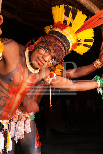 Xingu Indigenous Park, Mato Grosso, Brazil. Aldeia Matipu. Mapi Matipu in full ceremonial body paint and feather decorations during the Kuarup funeral ceremony.