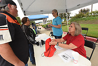 DEAL ME IN<br />Shelli Wiles (cq) helps motorcycle riders on Saturday Sept. 12 2020 draw their first poker chip at the 14th annual Summer Fun Run Ride For Life poker run. The ride is a fundraiser for Circle of Life Hospice, said Dee Vaughn with Circle of Life. An all-volunteer board and staff puts on the ride. Bikers covered a 119-mile route through Benton, Washington and Madison counties with five poker-chip draw stations along the way. Go to nwaonline.com/200913Daily/ to see more photos.<br />(NWA Democrat-Gazette/Flip Putthoff)