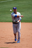 Midland RockHounds third baseman Renato Nunez (34) throws to first during a game against the Tulsa Drillers on June 3, 2015 at Oneok Field in Tulsa, Oklahoma.  Midland defeated Tulsa 5-3.  (Mike Janes/Four Seam Images)