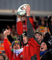 A fan catches a ball during the Steinlager Series rugby union match between the New Zealand All Blacks and Wales at Forsyth Barr Stadium, Wellington, New Zealand on Saturday, 25 June 2016. Photo: Dave Lintott / lintottphoto.co.nz