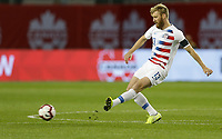TORONTO, ON - OCTOBER 15: Tim Ream #13 of the United States passes off the ball during a game between Canada and USMNT at BMO Field on October 15, 2019 in Toronto, Canada.