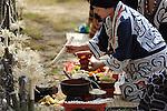 Ainu ritual during the Chipusanke Ainu festival inside a traditional Ainu house in Nibutani. Hokkaido. Japan.<br /> <br /> Rituel Ainu pendant le festival Chipusanke Ainu dans une maison traditionnelle Ainu à Nibutani. Hokkaido. Japon.
