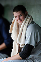 Pitcher Jordan Montgomery (34) of the Charleston RiverDogs smiles in the dugout during a game against the Greenville Drive on Saturday, May 23, 2015, at Fluor Field at the West End in Greenville, South Carolina. Charleston won 5-4. (Tom Priddy/Four Seam Images)