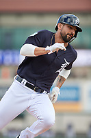 Detroit Tigers right fielder Nicholas Castellanos (9) runs the bases during a Grapefruit League Spring Training game against the New York Yankees on February 27, 2019 at Publix Field at Joker Marchant Stadium in Lakeland, Florida.  Yankees defeated the Tigers 10-4 as the game was called after the sixth inning due to rain.  (Mike Janes/Four Seam Images)