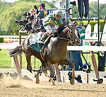 Honor Code (no. 9), ridden by Javier Castellano and trained by Claude McGaughey III, wins the 122nd running of the grade 1 Metropolitan Handicap for three year olds and upward on June 06, 2015 at Belmont Park in Elmont, New York. (Bob Mayberger/Eclipse Sportswire)