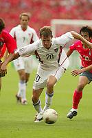 Brian McBride tries to turn upfield. The USA tied South Korea, 1-1, during the FIFA World Cup 2002 in Daegu, Korea.