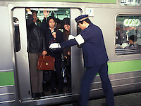 RAILWAY: TOKYO, JAPAN<br /> Commuters are squeezed onto a train during rush hour in central Tokyo.<br /> Photo by Richard Jones/sinopix<br /> ©sinopix