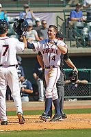 University of Virginia Cavaliers infielder Ernie Clement (4) scoring a run during a game against the Liberty University Flames at Joseph P. Riley Ballpark on February 17, 2017 in Charleston, South Carolina. Virginia defeated Liberty 10-2. (Robert Gurganus/Four Seam Images)