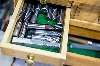 Dril bits in a wooden toolbox or tool Chest