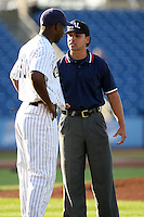 June 11th 2008:  Baseumpire Roberto Medina explains his call to Aaron Holbert of the Lake County Captains during a game at Classic Park in Eastlake,OH.  Photo by:  Mike Janes/Four Seam Images