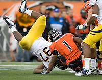 Cameron Jordan of California tackles Jacquizz Rodgers of Oregon State during the game at Reser Stadium in Corvallis, Oregon on October 30th, 2010.   Oregon State defeated California, 35-7.